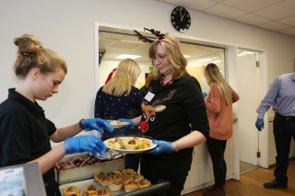 The Welbeloved Club Christmas Lunch, at the Memorial Hall, The Forebury, Sawbridgeworth. Volunteer Jean Palfreman delivering roast dinners.